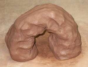 clay drying in an upside down U